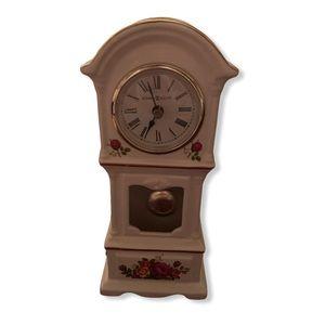 White Floral Howard Miller mini Grandfather clock